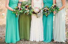 Crazy beautiful bouquets with protea, airplants, billy balls and a mix of greenery. Kate Whelan Events.