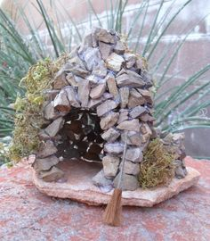 Add a touch of imagination to any garden or planter. This rock tower is a whimsical creation that can be used by many creatures of the garden.