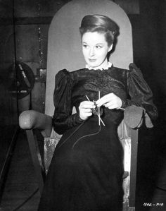 """Susan Hayward leans and knits between takes of """"The Lost Moment"""" ('47)."""