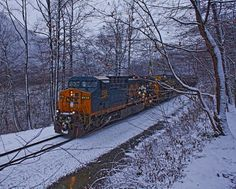 As the snow falls a train rushes empty coal cars back to the mines of West Virginia