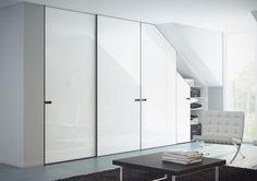 White fitted sliding mirror wardrobe doors