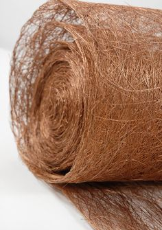"""Abaca Fiber Copper Brown Roll Natural 19"""" x 10 yards $17 Maybe for table runner? More natural and add the gold elsewhere? :D"""