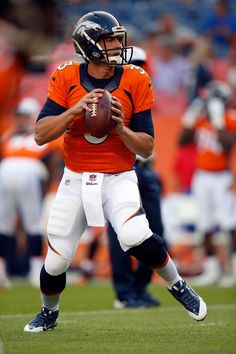 Trevor Siemian Photos Photos - Quarterback Trevor Siemian #3 of the Denver Broncos warms up prior to facing the San Francisco 49ers during preseason action at Sports Authority Field at Mile High on August 29, 2015 in Denver, Colorado. The Broncos defeated the 49ers 19-12. - San Francisco 49ers v Denver Broncos