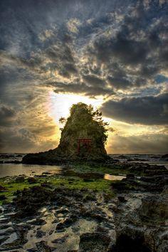 Shinto torii on small islet in the Pacific Ocean near Amatsu-kominato in the Boso Pensinsula of Chiba Prefecture, Japan.   by Jon Sheer