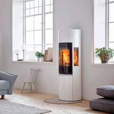 Contura Style Woodburning Stove from Contura. Buy Contura style stove in grey or black in Wales from Contura Approved retailer outlets in Carmarthenshire, Pembrokeshire and Ceredigion. Fireplace Seating, Home Fireplace, Modern Fireplace, Fireplaces, Walk In Closet Design, Closet Designs, Modern Wood Burning Stoves, Wood Burner, Iron Doors