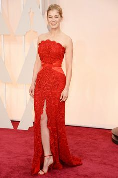 Rosamund Pike in a strapless red rose-textured Givenchy gown with a sexy slit at the 2015 Oscars