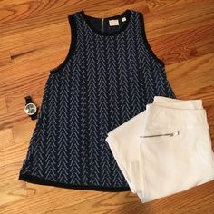 Anthropologie sleeveless top Navy and white embroidered tank with very sweet black organza detailing.  Can be worn year round, either by itself or under a jacket or sweater. Super versatile! Anthropologie Tops