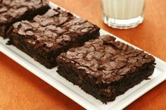 Brownies made with zucchini, bananas and applesauce, yielding a brownie with only 120 calories, 2 grams of fat, and a whole bunch of vitamins and minerals. .