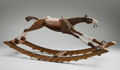 Objects in the exhibition include this adorable wooden rocking horse from the 1920s. — at National Museum of Australia.
