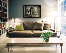 Living Room Photo - A stone-topped coffee table paired with a roll-arm couch and gray walls