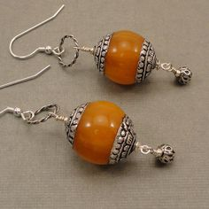 Amber & Silver Earrings. http://www.etsy.com/listing/93753390/tibetan-amber-and-sterling-silver?utm_source=Pinterest_medium=PageTools_campaign=Share