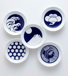 blue and white Japanese plates - KAMON Not normally a fan of designs on crockery, but these are so simply pretty!
