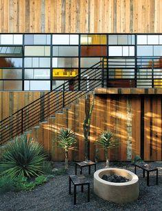 Nice design - vertical cladding with long horizontal windows.