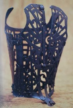 """Corset made in France in 1580-1600  Eleanor of Toledo had a metal corset which kept her upright in her last days when she had swiftly declining health. Most research points to metal cage-like corsets being used as medical devices and not by the average woman for everyday wear. Ah, once again the Victorians warped an aspect of history. Picture features in """"Corsets and Crinolines"""", which is a good read for folks interested in historical corsets (along with Waisted Efforts)."""