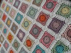 Crochet Circle in s Square blanket, two color squares.