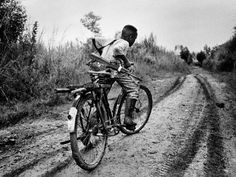 Photograph by Marcus Bleasdale Already a soldier, a boy with an assault rifle pedals to base camp during fighting in the Ituri region in 2003. Photographer Marcus Bleasdale says that of all of his images from the Congo, this one has provoked the most response from the public.