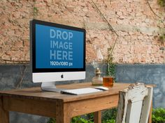 New! iMac on Top of a Wooden Desk at a Creative Office Mockup. Try it here: https://placeit.net/stages/imac-on-top-of-a-wooden-desk-at-a-creative-office-mockup-a4865