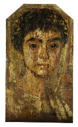 A PAINTED WOOD FAYUM PORTRAIT OF A YOUTH