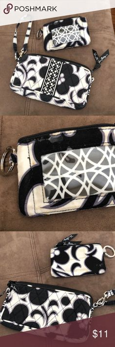 Very Bradley wristlet and ID holder Very Bradley wristlet and ID holder, discoloration from use, but clean!  Vera holds up very well! Vera Bradley Bags Clutches & Wristlets
