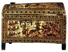 KING TUT: Painted chest, from the Tomb of Tutankhamen, Thebes, Egypt, ca. 1333-1323 BCE. Wood, approx. 1' 8 long. Egyptian Museum, Cairo. Although Tutankhamen probably was considered too young to fight, his position as king required that he be represented as a conqueror. (Gardner's)