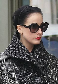 Wind it into a simple ballerina bun and add a thin, chic headband, like Dita Von Teese