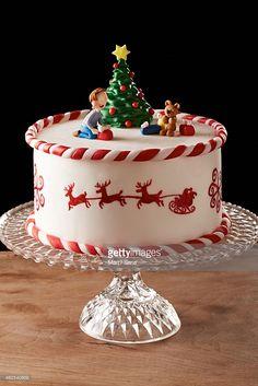 Fondant Christmas tree cake on black background
