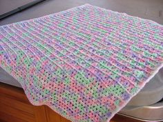 """One Skein Lap Throw, free pattern (no. LW1625) from Red Heart (* jumbo 14-oz skein).  32"""" x 37"""", would make a nice baby blanket, too.  Cluster V-stitches separated by FPDC & BPDC.  Pic from Ravelry Project Gallery   . . . .   ღTrish W ~ http://www.pinterest.com/trishw/  . . . .  #crochet #afghan #blanket #throw"""