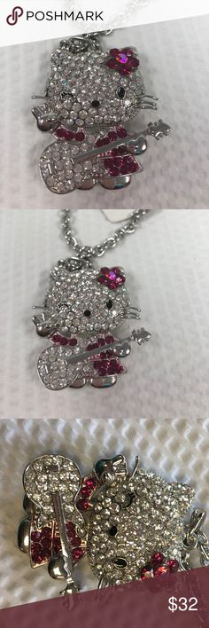 Hello Kitty Pendant Necklace Hello Kitty Pendant Necklace. With guitar and winking atcha.. Hello Kitty Jewelry Necklaces