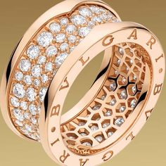 Bulgari ring in 18kt pink gold with pave diamonds....umm, yes this needs to be on my wedding ring finger:-)