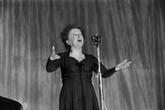 French singer Edith Piaf performs in 1960 on stage at the Olympia concert hall in Paris. One hundred years after her birth, Piaf remains an icon of Paris to the world, as shown by the many tributes to the capital through her songs after the attacks of Nov. 13. | AFP-JIJI