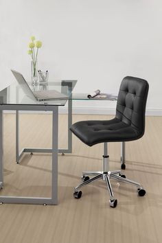 This leatherette armless swivel office chair adds a modern touch to any office. A strong steel base with five swiveled wheels is topped with a chair with stylish buttons. A height adjustment offers comfort, and the chair comes in solid black or white. Black Office Chair, Swivel Office Chair, Home Office Chairs, Modern Furniture Online, Office Furniture Stores, Affordable Furniture, Contemporary Office, Contemporary Furniture, Chic Dorm