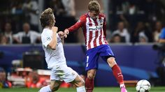 Luka Modrić challenges Antoine Griezmann but neither side could find a winner in normal time