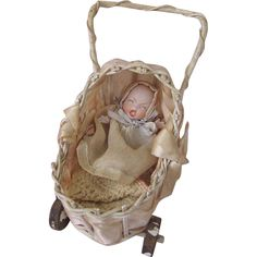 Rare Gebruder Heubach Screaming Baby All Bisque in Wicker Baby from dollsandlace on Ruby Lane