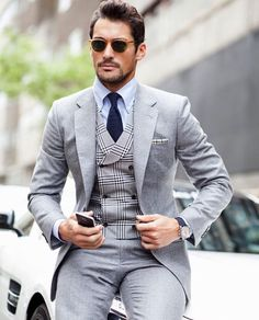 David Gandy with a gray suit with a plaid double breasted waistcoat light blue button collar shirt navy tie sunglasses houndstooth pocket square blue leather banded watch Mens Fashion Suits, Mens Suits, Men's Fashion, Fashion Menswear, Dark Fashion, David Gandy Style, Grey Suit Men, Grey Suits, Look Blazer