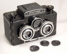 The Sputnik (travel companion or fellow traveler in Russian) can take six 6x6 stereo pairs on a standard 120 rollfilm. Of course, the film has to be advanced to every odd numbered frame (1, 3, 5 etc). The camera was made by GOMZ (now LOMO) in the 60's.   Shutter speeds are: B, 1/10 - 1/100. Taking lenses: T (Triplet)-22, coated, f=7.5 cm, 1:4.5, aperture settings from 4.5 to 22. The camera has a self-timer and a PC flash terminal.