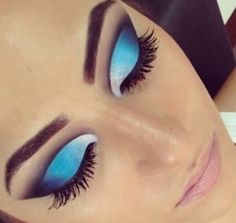 Heavy blue eye makeup