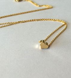 This tiny gold heart charm hangs on a 1.3mm gold plated chain.