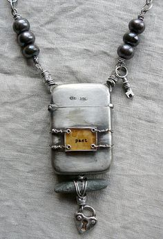 vintage lighter becomes necklace centerpiece by Nina Bagley (about a 1/4ish way down the blog page)