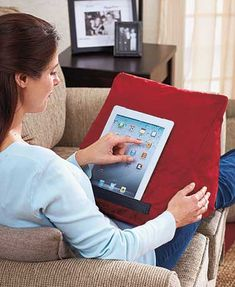 """This handy Tablet Wedge lets you comfortably use your tablet or e-reader anywhere. Offering handsfree convenience, it holds your device at just the right angle for easy viewing. Perfect for use while lounging in bed. You can even use it as a pillow. 10""""W"""