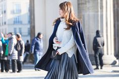 I love the light texture of my metallic pleated skirt and combined it with a chunky oversize turtle neck sweater, which really kept me warm. I'm wearing my tailor made cashmere coat, which I designed and had it tailored at my favorite store in Shanghai and thigh high boots instead of heels  http://www.theclassycloud.com/metallic-skirt-fashion-week-berlin.html