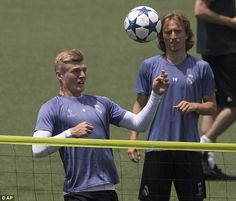 Toni Kroos controls the ball as fellow central midfielder Luka Modric watches the German