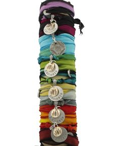 Beautifully hand dyed silk wrap bracelet with Namaste and lotus charm. Made in the USA, available at BuddhaGroove.com.