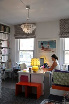 Love the matching yellow lamps and pendant light - glamorous workspace