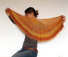 Simple but has great colourstyle.  Ravelry: Sunray Shawl pattern by dunkelgrün