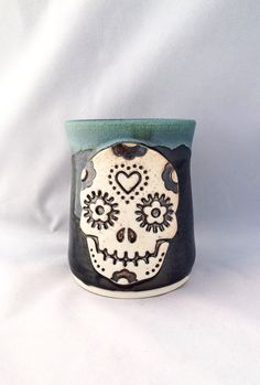 Large stoneware pottery tumbler (10 oz), green and metallic black glaze, Day of the Dead skull (Día de los Muertos), perfect for Halloween by CenteredVessel on Etsy