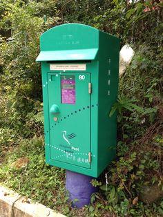 A green and small size Hong Kong post box from Po Lin Monastery, Lantau Island.