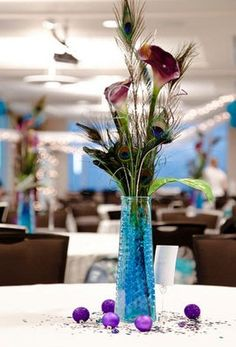 Peacock feather centerpieces $10