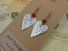 Primitive Heart Earring with Swarovski Bead.  Recycled Soda Can Art. DOUBLE-sided. Embossed.. $9.95, via Etsy.