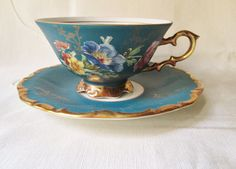 This Vintage Bavarian cup and saucer was produced by Waldenshof Porcellan Manufactory between1925 and 1970. It has a matte finish and is