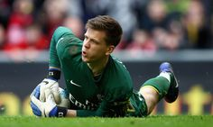 Wojciech Szczesny Photos Photos - Wojciech Szczesny of Arsenal saves a shot during the Barclays Premier League match between Liverpool and Arsenal at Anfield on March 3, 2012 in Liverpool, England. - Liverpool v Arsenal - Premier League